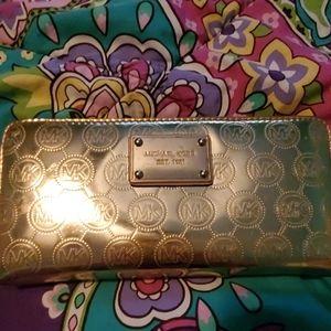 Authentic Michael Kors Gold Zippy Wallet